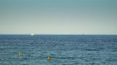 A Small Boat Sailing Sails on the Sea - stock footage