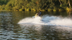 Young girl on jet ski Stock Footage