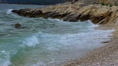 Waves are lapping against a pebbly beach Stock Footage