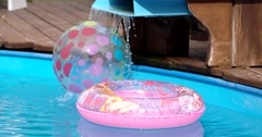 Children Buoy and Inflatable Ball at Swimming Pool Stock Footage