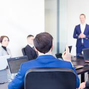 Colleague asking question to business team leader. Stock Photos