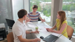 Men and women are talking in the office - stock footage
