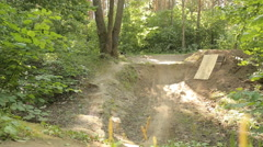 Bmx biker riding in forest Stock Footage