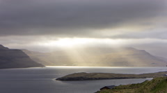 Moving clouds above the mountains and the sea, Faroe Islands, 4K time lapse Stock Footage