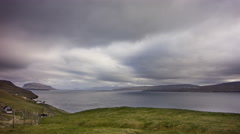 Moving clouds above the ocean near Toftir, Faroe Islands, 4K time lapse Stock Footage