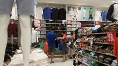 Shenzhen, China: clothing store and display of the latest fashion Stock Footage