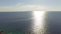 Speedboat on Croatian coast, endless sea horizon. Ocean, open sea scene Stock Footage