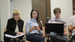 Five young people are talking in the office - stock footage