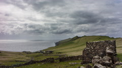 Abandoned stone house with distant views of cliffs and a village, 4K time lapse Stock Footage