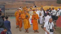 Pilgrims carrying robe for buddha to temple,Kushinagar,India Stock Footage