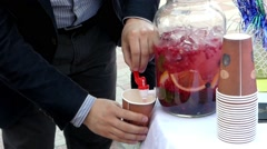 The Hand of the Guy Pouring the Lemonade Closeup. Stock Footage