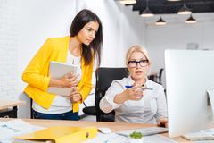 Businesswomen having a brainstorm meeting in the office Stock Photos