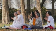 Pilgrims meditating  at cremation stupa,Kushinagar,India Stock Footage