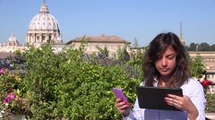 Businesswoman in Vatican Rome basilica reading tablet smart phone carefully 4K - stock footage