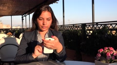 Busy businesswoman working outdoor on mobile gadget phone used cafe bar view 4K Stock Footage