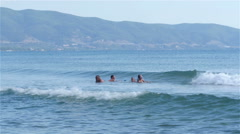 People have fun in the beautiful wavy sea in slow motion by Sheyno. Stock Footage