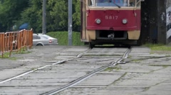 Wheels of Red Tram Rides on the Railway. Stock Footage
