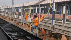 Man cleaning railway tracks in station,Gorakhpur,India Stock Footage