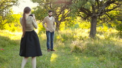 Man photographing woman Stock Footage