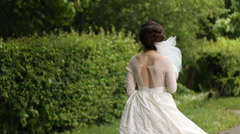Bride smilling with the bouqet in the park Stock Footage