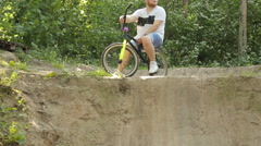 Man on bmx in the woods the sun Stock Footage