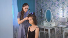 A stylist making hair to a beautiful bride before the wedding in a morning Stock Footage