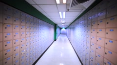 Walking along the corridor with thousands of post office boxes. Stock Footage