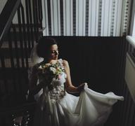 Bride posing on the chamber - stock photo