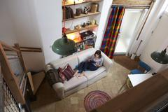 Woman Relaxing With Digital Tablet In Stylish Apartment Stock Photos