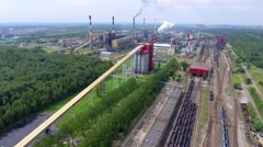 Above-ground gas, oil and heat pipes rack in factory area. Coal mine. Stock Footage