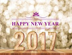 Happy new year 2017 wood number in perspective room with sparkling gold bokeh - stock illustration