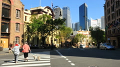 Australia Sydney crossing street with dogs in The Rocks Stock Footage