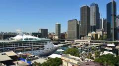 Australia Sydney cruise ship moored and skyline Stock Footage