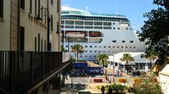 Australia Sydney cruise ship beyond street Stock Footage