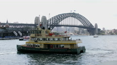 Australia Sydney Harbour Bridge with ferry turning Stock Footage