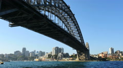 Australia Sydney Harbour Bridge with motorboat passing under Stock Footage