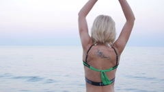 Blond Girl Enjoy Fresh Air during the Summer Sunset on the Beach - stock footage