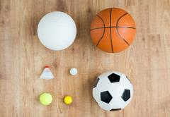Close up of different sports balls and shuttlecock Stock Photos