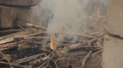 Flames of wood ember with smoke and flash fire. - stock footage