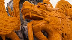 dragon candle carving for Buddhist Lent - stock photo