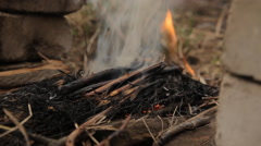 Wood ember with smoke and spurts of flame. Stock Footage