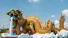 Dragon statue against blue sky Stock Photos