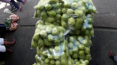 Man pushes Vegetable Cart. overhead shot Stock Footage