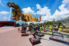 Giant Dragon monument and Chinese Kung fu statue Stock Photos