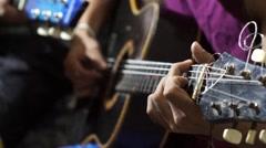 Guitarists  strumming guitar - stock footage