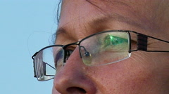 4K. Face of  adult woman  in glasses close up Stock Footage