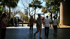 Australia Sydney people walk in park with ship beyond Stock Footage