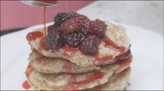 Pancakes decoration with raspberry compote Stock Footage