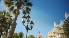 Waving palm trees and casino at Monaco, Cote D'Azur France Stock Footage