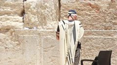 Jerusalem holy land Israel western wall man pray Stock Footage